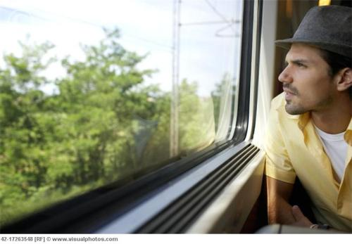 Man Looking Out Train Window