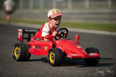 Kid with ferrari