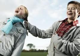 Boy pulls girl's hair