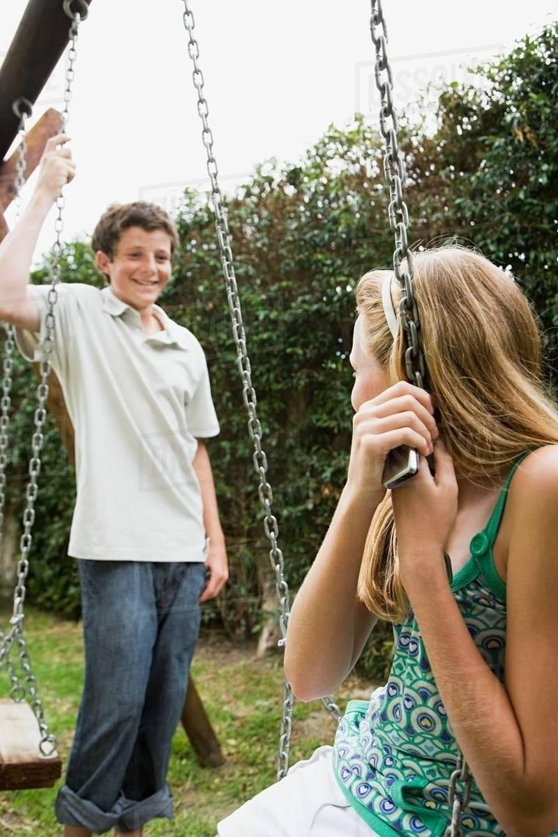 boy and girl on swings.jpg