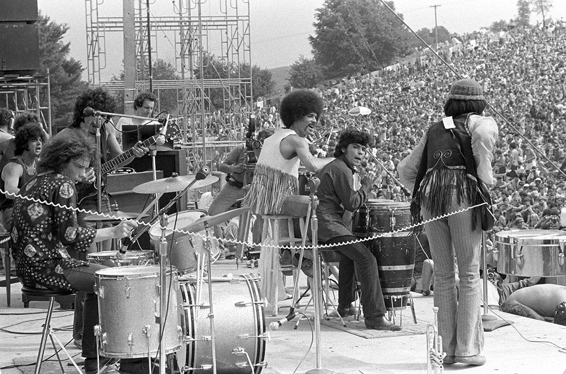 Carlos Santana and band on Stage at Woodstock Music & Art Fair